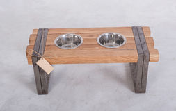 Metal Pet dish on wood table Stock Photography
