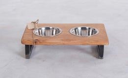 Metal Pet dish on wood table Stock Photos