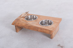 Metal Pet dish on wood table Royalty Free Stock Image