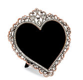 Metal photo frame inlaid with rhinestones in form of heart Stock Image