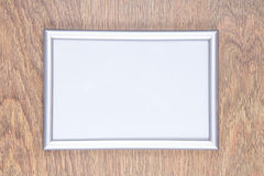 Metal photo frame on the table Stock Images