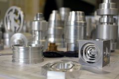 Metal Pieces. Machined on CNC by students Royalty Free Stock Photos