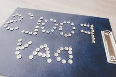 Metal Pins Making Inscription Fools Day on Tablet. royalty free stock photography