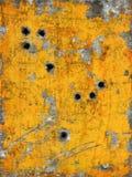 Metal pintado con los agujeros Imagenes de archivo