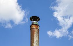 Metal pipe against the sky. Stock Photography