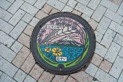 Metal pipe cap on street at Kawaguchiko lake in Japan. stock photo