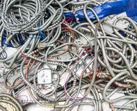 Metal pipe heap for the wiring harness. Royalty Free Stock Images