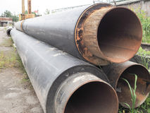 The metal pipe. Large diameter wide metal pipes covered with a layer of black rubber. Royalty Free Stock Photo
