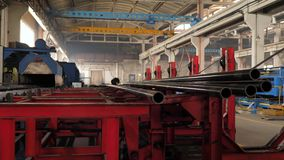 Metal Pipe Plant. Plant for the production of metal pipes, loading pipes on the machine stock video