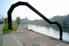 Metal pipe in Vilnius city on the board of Neris river Royalty Free Stock Photo