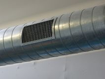 Metal pipeline and nozzle of an air conditioning system. Metal pipeline and nozzle part of an air conditioning system of a big building stock photos