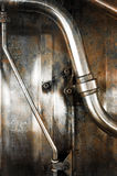 Metal pipes. Closeup of industrial metal pipes and tubing Royalty Free Stock Images