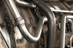 Metal pipes. Closeup of industrial metal pipes and tubing Stock Image