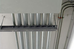 Metal pipes on the ceiling Stock Photos