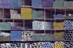 Metal pipes for construction on shelf Royalty Free Stock Photo