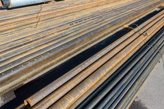 Metal pipes horizontally. Round metal pipes on asphalt, close-up of a cut stock photo