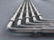 Metal pipes mounted on a wall Stock Photo