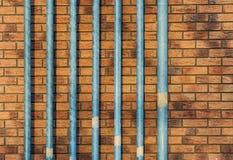 Metal pipes red brick wall Royalty Free Stock Photos
