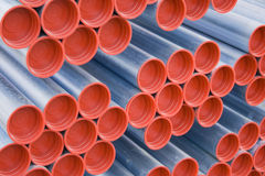 Metal pipes with red caps. A lot of metal pipes with red caps stock images