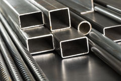 Metal pipes and rods. Steel materials, construction supplies Royalty Free Stock Photography