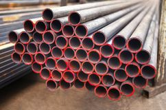 Metal pipes of same diameters. Stocked in storage Royalty Free Stock Photo