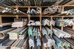 Metal pipes on shelf Stock Photo