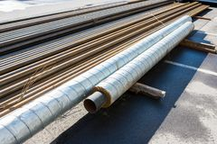 Metal pipes with thermal insulation in production. Metal pipes with thermal insulation combined in production stock photos