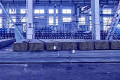 Metal pipes in a warehouse. Stacks of new square steel pipe in f Royalty Free Stock Photo