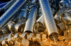Metal pipes. Waste of metal perforated corrugated pipes on pile Royalty Free Stock Photography