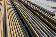 Metal pipes for water supply. Metal pipe stainless stacked wait for material in manufacturing stock photography