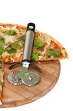 Metal pizza cutter with pizza of letuce Royalty Free Stock Images