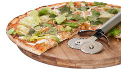 Metal pizza cutter with pizza of letuce Royalty Free Stock Photos