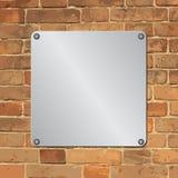 Plaque. Metal plaque on brick wall Stock Photos