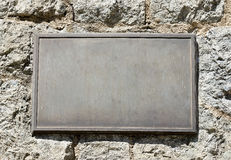 Metal Plaque on Stone Wall Stock Photos