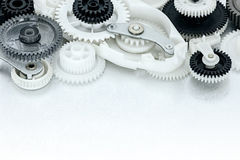 Metal and plastic cogwheels and other parts of industrial machin. Ery closeup Stock Photography