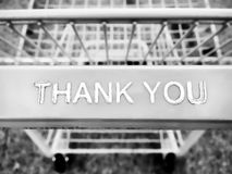 Metal and plastic shopping cart with a thank you note message closeup. Close up Stock Photography