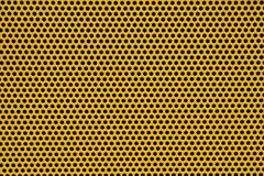 Metal plate. Yellow metal plate texture with holes Stock Photos