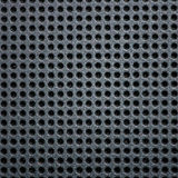 Metal plate as background. Black, metallic sheet with holes Stock Images