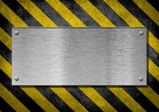 Metal plate background with hazard stripes. New metal plate background with hazard stripes stock image