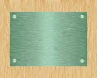 Metal plate on board. Green metal plate on board Stock Photo