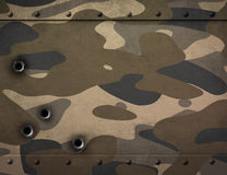Metal plate with camouflage and bullet holes 3d illustration Royalty Free Stock Photos