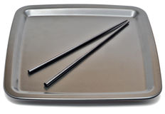 Metal plate with chopsticks Stock Photo