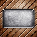 Metal plate on copper background Royalty Free Stock Photography