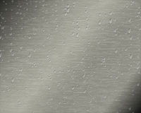 Metal plate with drops of water Stock Image