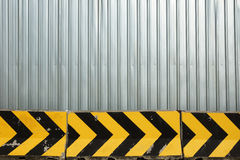 Metal plate fence and concrete barrier Royalty Free Stock Photo