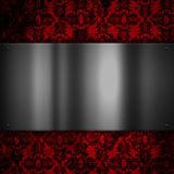 Metal plate on a floral grunge background Stock Image