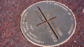 Metal plate of Four Corners in USA Stock Images