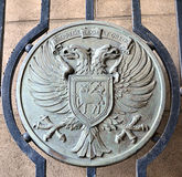 Metal plate on a gate displaying coat of arms of City of Perth,. Circular cut-out from a gate on a former building of Perth City Council (the council being stock photography