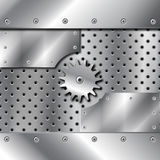 Metal plate and gears Royalty Free Stock Photo