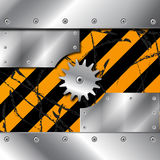 Metal plate and gears on dirty grunge Stock Image